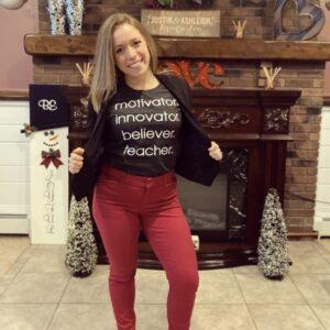 Ashleigh in teacher shirt